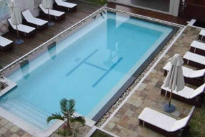 Grand Bay Suites Mauritius swimming pool and sunbeds